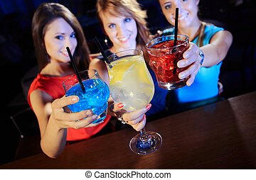 Cocktail party - Group of happy beautiful young female...