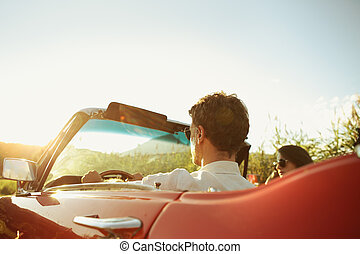 Vintage Car Couple - Couple driving convertible car enjoying...