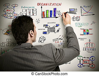 Businessman drawing organisation scheme - Businessman and...