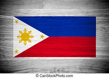 Philippines flag on wood texture