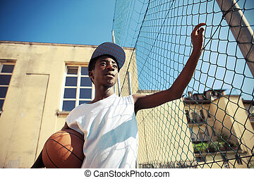 Street Basketball - Portrait of african boy with basketball...
