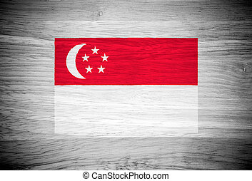 Singapore flag on wood texture