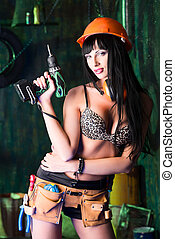 alluring builder - Stunningly sexy girl posing with tools in...