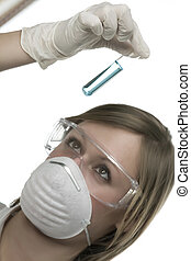 young woman in laboratory with test tube