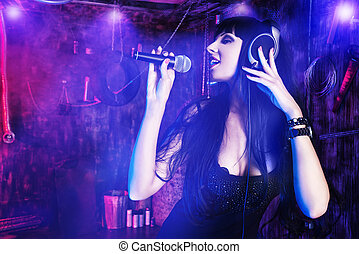 singing girl - Beautiful sexy girl singing on a party in the...