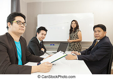 Young business people are working in the meeting room.