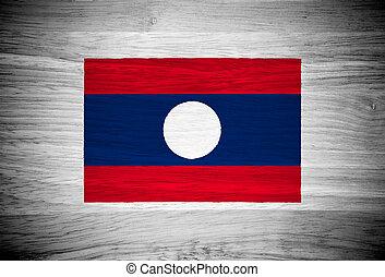 Laos flag on wood texture