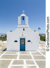 greek chapel isolated on blue sky.