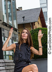 beautiful young woman making a funny gesture