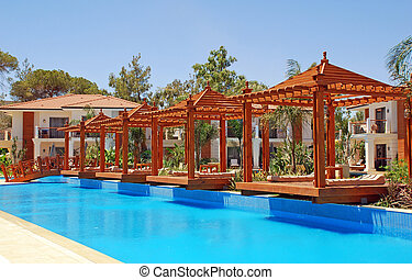 pool and wood pergola - Summer landscape with resort...