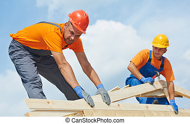 Roofers carpenters works on roof - Two construction roofer...