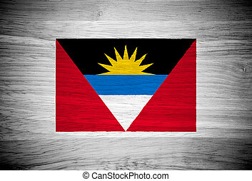 Antigua and Barbuda flag on wood texture