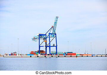 Port cargo crane and container over blue sky