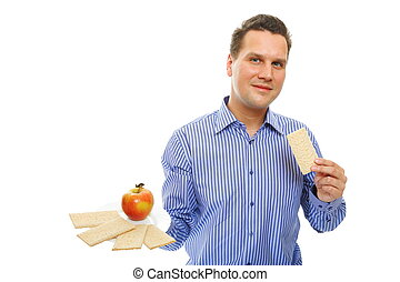 Healthy lifestyle man eating crispbread and apple - Positive...