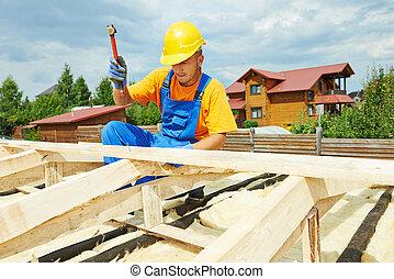 Roofer works on roof - roofer carpenter worker nailing wood...