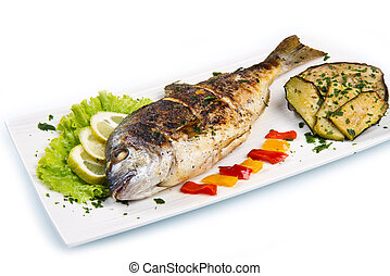 Grilled gilt head sea bream on plate with lemon salad and...
