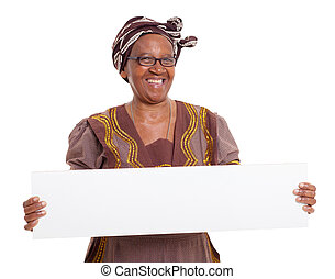 senior african woman holding blank banner on white...