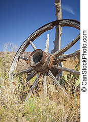 Old wagon wheel - Lone wagon wheel in a prairie, Utah