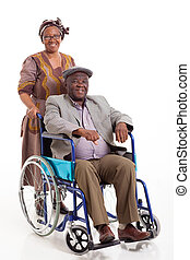 disabled African old man sitting on wheelchair with caring wife on white background