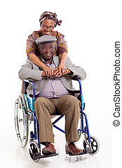 loving african wife hugging disabled husband on white...