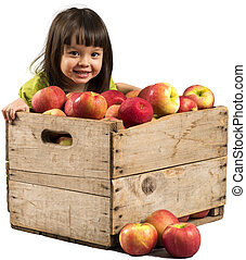 Little girl with apples - Little girl smiling with crate...