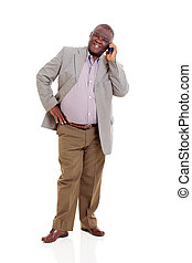 elderly african man talking on mobile phone