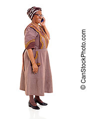 elderly african woman talking on cell phone