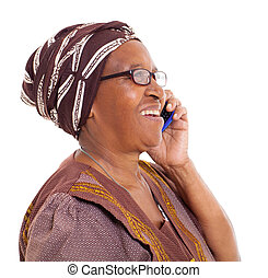 elderly african woman talking on smart phone - happy elderly...