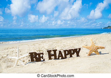 "Sign ""Be Happy"" and two starfishes on the sandy beach by the..."
