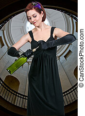 Woman Opening Wine - Beautiful woman opening a fine wine...