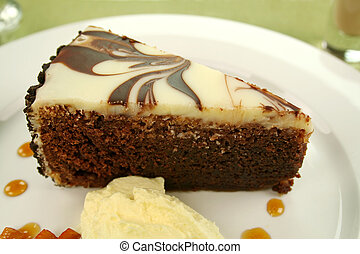 Chocolate Cake Slice - Rich chocolate cake with orange...