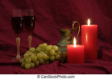 Wine and Grapes - Wine, grapes and candlelight suggesting...