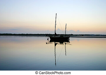 Old Ketch Before Dawn - Old vintage ketch moored in a lagoon...