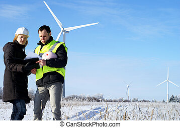 engineers with wind turbines