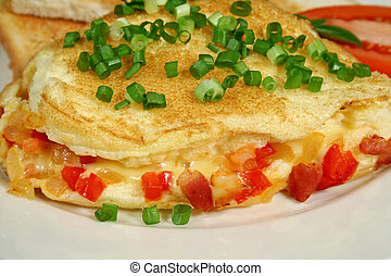 Omelette 2 - Freshly made omelette with toast and tomato