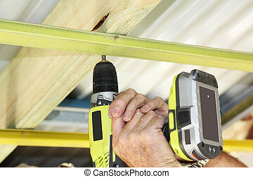 hand drill - a cordless hand drill used to put ceiling...