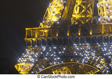 eiffel tower lit up at night - close-up shot of the eiffel...