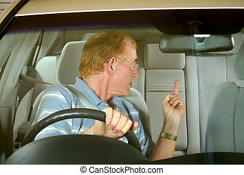 Road Rage 4 - Middle aged man gives rude sign in road rage...