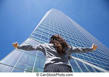 businesswoman adoring crystal skyscraper - business woman...
