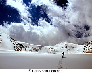 Hiker in the snow mountains - Hiking on a glacier in...