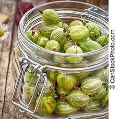 berries gooseberry in a glass jar