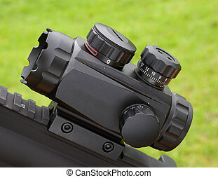 Rifle scope - Black reflex style optic that is used on a...