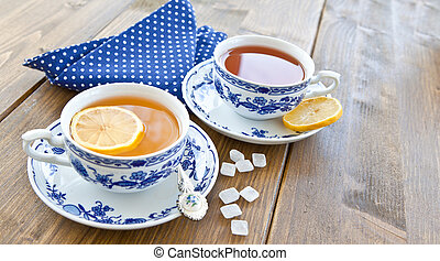 Various tea in china cups - Various teas with fresh lemon in...