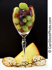 Happy Hour - Wine glass with grapes cheese, crackers, and a...