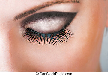 Close-up of closed beautiful eye with long sexy false lashes