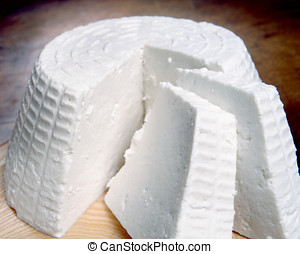 Italian ricotta cheese, a soft cheese resembling cottage...