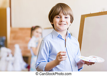 Cute boy painting - Image of little cute boy painting...