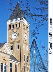 Dualing points in Benton, Arkansas - A Christmas tree light...