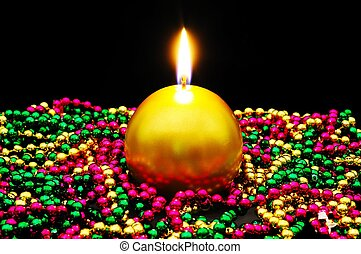 Christmas candle and beads. - Round gold Christmas candle...