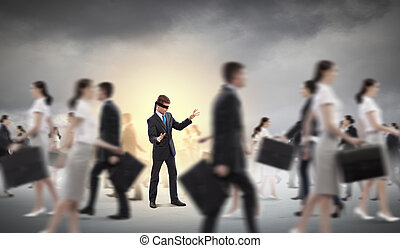 Businessman in blindfold among group of people - Image of...